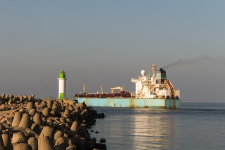 Chemical tanker leaving the port in beautiful weather.