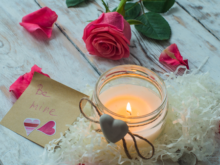 Burning candle and pink rose. love card. Valentines Day postcard.