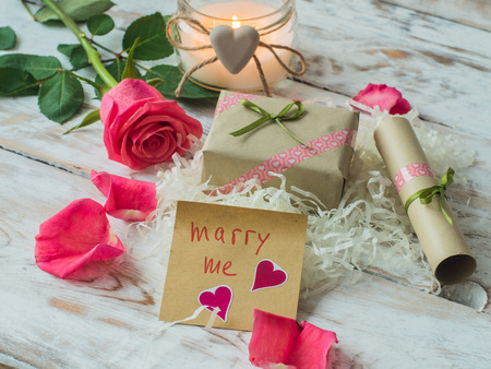 Will you marry me words written on paper, love card. Valentines Day background, love postcard. Stock Photo
