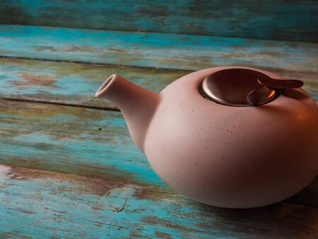 Image of traditional teapot on rustic background