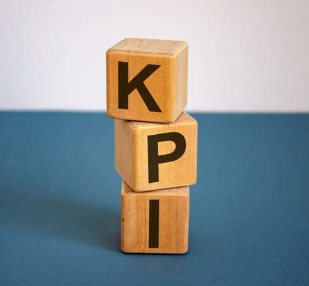 Concept word KPI on cubes on a beautiful blue background.