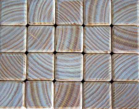 Photo of many small wooden cubes of different heights, tightly lying one after another, imitating the texture of the wall Stok Fotoğraf