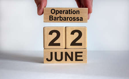 Male hand puts a block with the inscription 'operation barbarossa' on cubes with the date June 22th. Beautiful white background, copy space. Reklamní fotografie