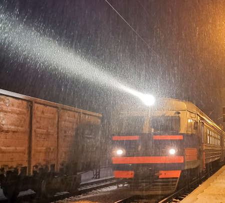 Evening train arrives at station. Snowfall complicates transportation of passengers, snow blockades. Blizzard and Snow drifts