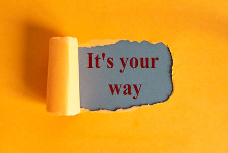 The text It`s your way appearing behind torn yellow paper.