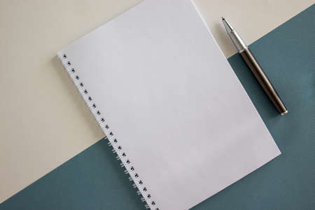 Notebook and pen on beautiful blue and white paper. Concept. Empty space for your text.