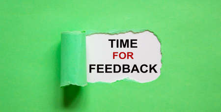 The text 'time for feedback' appearing behind torn green paper.