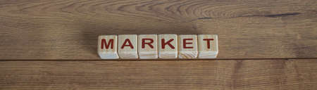 concept word market on cubes on a beautiful wooden table
