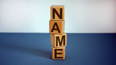 Concept word 'name' on cubes on a beautiful blue background. Business concept. Foto de archivo