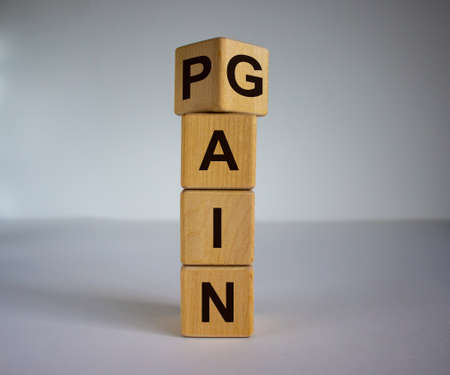Flipping wooden cubes for change wording between pain to gain. Mindset for career growth business.