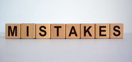 Concept word 'mistakes' on cubes on a beautiful white background.
