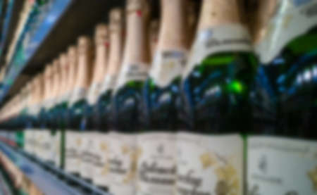 Blurred abstract background of shelf in supermarket. Alcohol showcase blurred background.