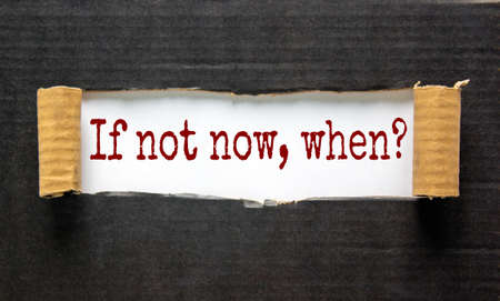 The words 'if not now, when' appearing behind torn black paper. Beautiful background. Business concept. 版權商用圖片 - 150628240