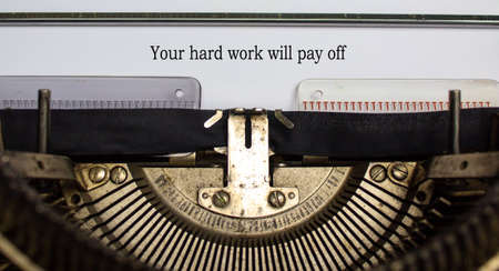 Text 'your hard work will pay off' typed on retro typewriter. Business concept. Stock fotó