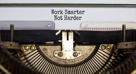 Text 'work smarter not harder' typed on retro typewriter. Business concept. Beautiful background.