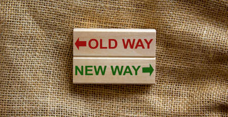 Old way vs new way, improvement and change management business concept. Wooden blocks on beautiful canvas background.