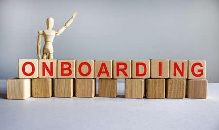 'Onboarding' written on wood blocks. Business concept. Wooden model of human. Copy space. Standard-Bild