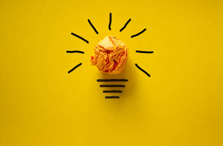Idea and innovation concept image. Beautiful yellow background. Foto de archivo