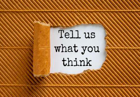 The text 'tell us what you think' appearing behind torn brown paper. Beautiful background. Business concept.