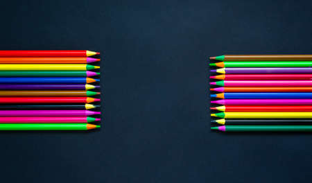 Color pencils on a beautiful dark background. Copy space.