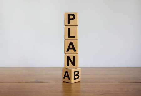 Time for Plan B. Turned cube and changing the word 'Plan A' to 'Plan B'. Beautiful white background. Business concept. Copy space.