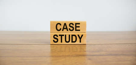 Wooden blocks form the text 'case study' on beautiful wooden table, white background. Business concept, copy space.