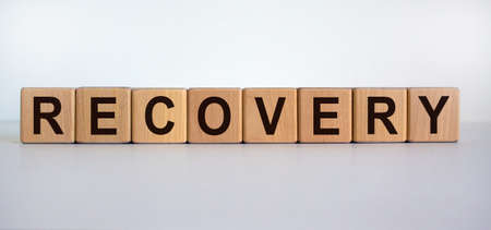 Concept word 'recovery' on cubes on a beautiful white background. Business concept.