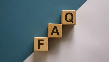Concept word 'FAQ' on cubes on a beautiful white and blue background. Business concept.