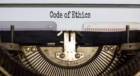 Text 'code of ethics' typed on retro typewriter. Business concept. Beautiful background.