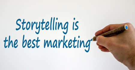 Hand writing 'storytelling is the best marketing', isolated on beautiful white background. Concept.