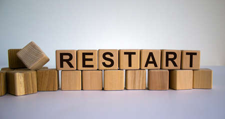 Concept word 'restart' on cubes on a beautiful wooden table. White background. Business concept. 免版税图像