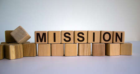 Concept word 'mission' on wooden cubes on a beautiful white background. Business concept.