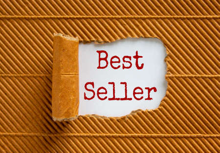 The text 'best seller' appearing behind torn brown paper. Beautiful background. Business concept.