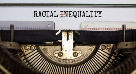 Words 'racial inequality' changed to 'racial equality' typed on retro typewriter. Concept. Beautiful background.