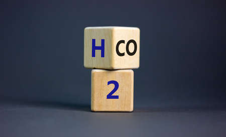 Change to fuel cell vehicles.Fliped a cube and changed the expression CO2 to H2. Beautiful gray background. Ecological concept.