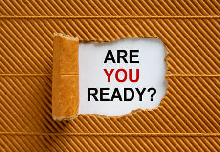 The text 'are you ready' appearing behind torn brown paper. Beautiful background. Business concept.