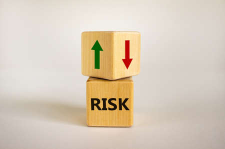 Wooden cubes with word 'risk' and arrows. Beautiful white background. Copy space. Business concept. Stok Fotoğraf
