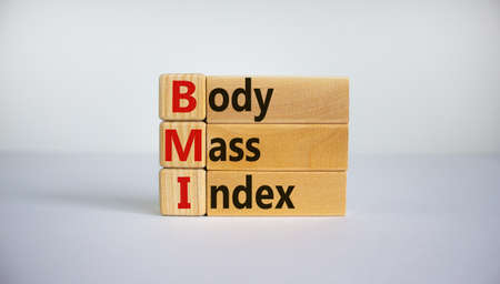 Cubes and blocks form the expression 'BMI - Body Mass Index'. Beautiful white background, copy space. Concept.
