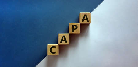 Concept words 'CAPA, corrective and preventive actions' on wooden cubes on a beautiful white and blue background. Business concept. Copy space. Stok Fotoğraf
