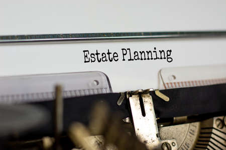 Text 'estate planning' typed on retro typewriter. Business concept.