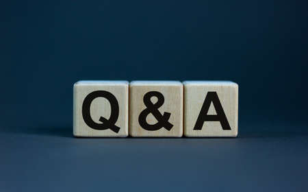 Concept word 'Q and A' on cubes on a beautiful gray background. Business concept, copy space. Banco de Imagens