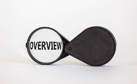Magnifying glass with word overview on beautiful white background. Business concept, copy space.