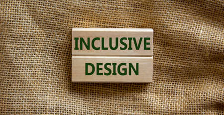 Inclusive design symbol. Wooden blocks form the words 'inclusive design' on beautiful canvas background. Inclusive design Concept. Copy space.