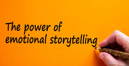 Power of emotional storytelling symbol. Hand writing 'The power of emotional storytelling', isolated on beautiful orange background. Business and storytelling concept, copy space.
