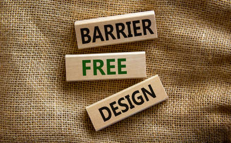 Barrier free design symbol. Wooden blocks with words 'Barrier free design' on beautiful canvas background. Business, inclusivity amd barrier free design concept.