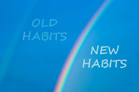 Old or new habits symbol. Rainbow in the blue sky. Words 'old habits, new habits'. Peaceful nature. Copy space. Business and old or new habits concept.