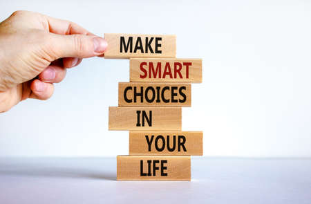 Make smart choice symbol. Concept words 'Make smart choice in your life' on wooden blocks on a beautiful white background. Businessman hand. Business and make smart choice concept. Copy space.