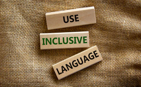 Use inclusive language symbol. Wooden blocks with words 'Use inclusive language'. Beautiful canvas background. Business and use inclusive language concept. Copy space.