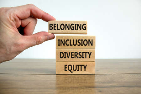 Equity, diversity, inclusion and belonging symbol. Wooden blocks with words 'equity, diversity, inclusion, belonging' on beautiful white background. Diversity, equity, inclusion and belonging concept.