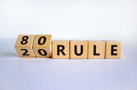 80 on 20 rule symbol. Pareto principle. Turned wooden cubes with words '80 on 20 rule '. Beautiful white background, copy space. Business and 80 on 20 rule, pareto principle concept. Reklamní fotografie